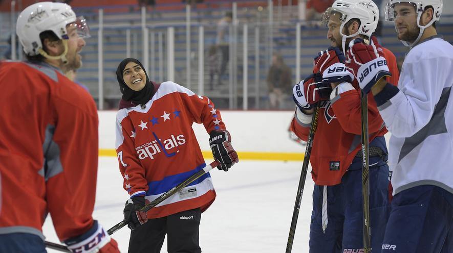 United Arab Emirates women s hockey player Fatima Al Ali (second from left)  talks to 57b35bf626