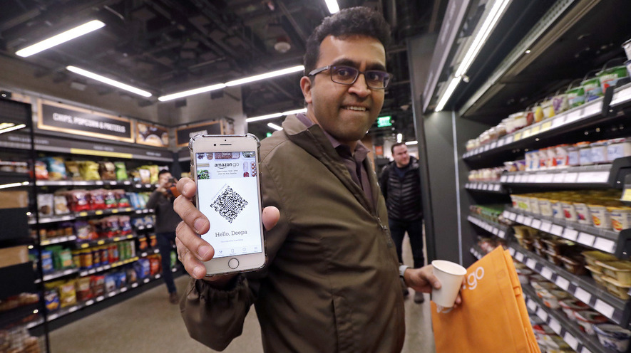 191546fecce7ee Amazon employee Krishna Iyer shows off an Amazon Go app as he shops in the  store on January 22, 2018, in Seattle, Washington. The store allows  shoppers to ...