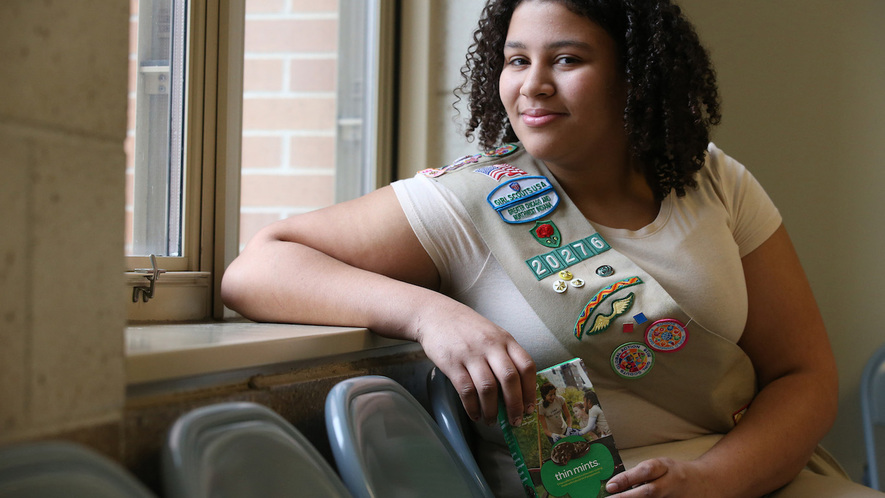 "Phoebe Williams, an eighth-grader at George B. Armstrong elementary school in Chicago, Illinois, sold 5,155 boxes of Girl Scout Cookies last year. Her sales earned her a ""Cookie CEO"" title. Photo by Antonio Perez/Chicago Tribune/TNS"