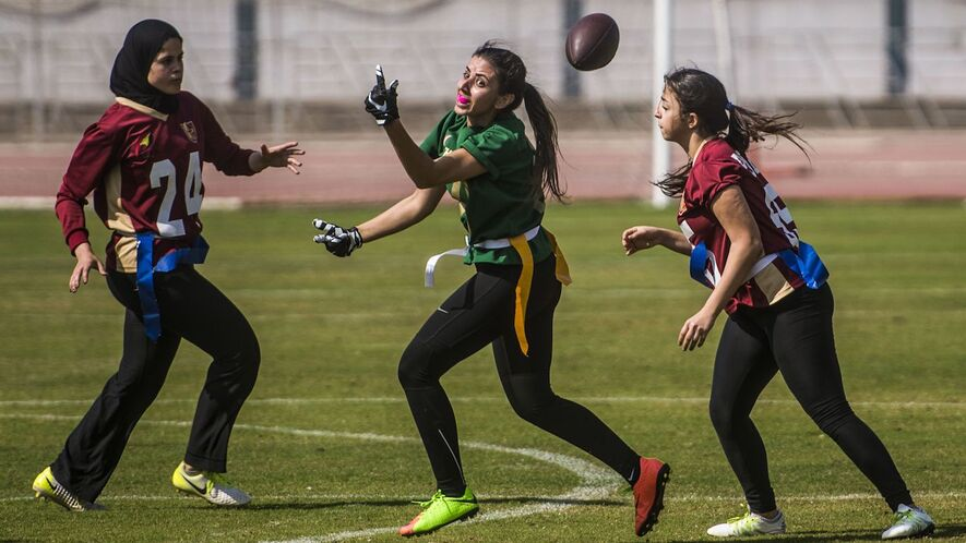 Flag football players from AUC Titans (red) play against Gezira Thunder  (green) a92e35514